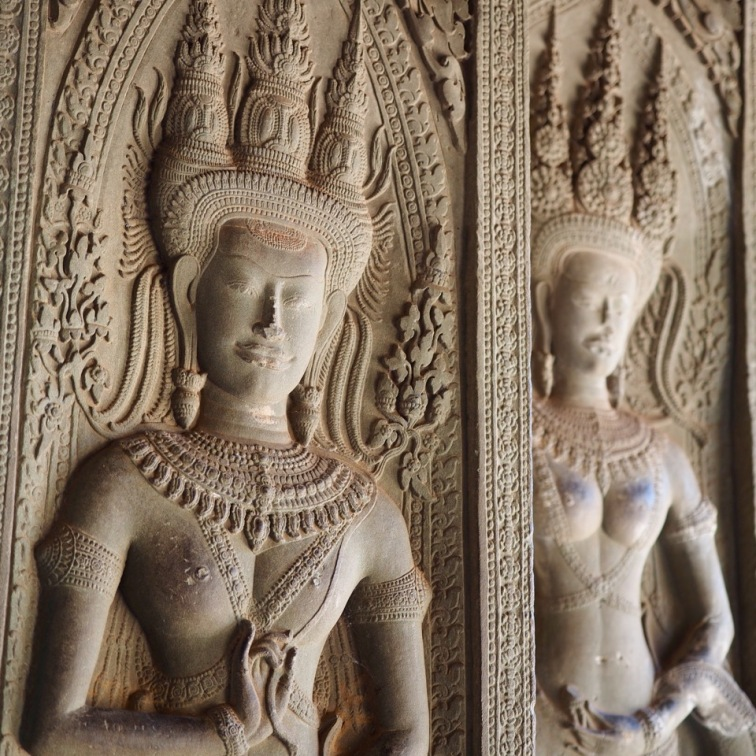 Apsaras carved along the walls